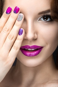beautiful-girl-with-bright-evening-make-up-purple-manicure-with-rhinestones-nail-design-beauty-face-picture-taken-studio-black-background_151428-794